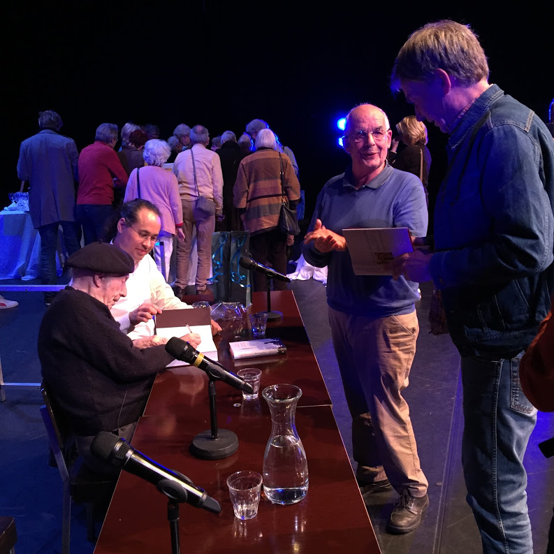 "Edgar Hilsenrath signing books at the theater performance of ""De nazi en de kapper"" (""The Nazi and The Barber"") in Haarlem, near Amsterdam, October 2016."